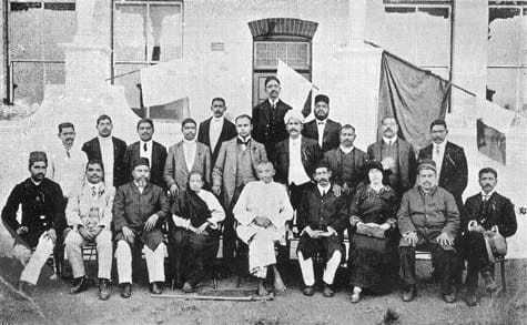 The last photograph of Kasturba and Mahatma Gandhi in Durban, South Africa along with several friends before their return to India, July 1913.