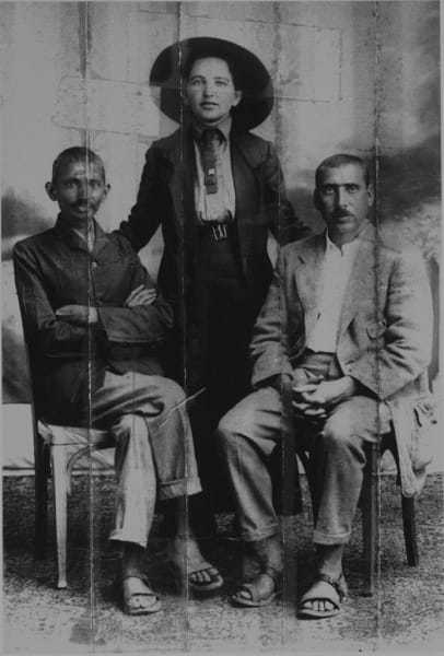 Gandhi, Sonia Schlesin, his secretary, and Dr. Hermann Kallenbach. Kallenbach sewed this photo in the collar of his jacket before joining Gandhi in England during the First World War. Being of German origin, he feared being arrested and the image seized. He was effectively arrested, but the police never discovered the photo. 1913.