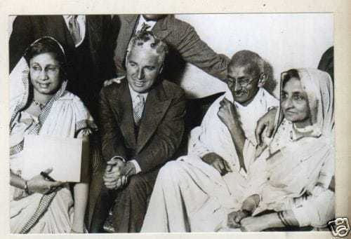 Charlie Chaplin with Mahatma Gandhi in Canning Town, London, 1931.