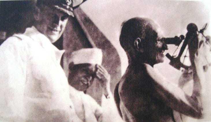 Gandhi handling a nautic instrument on the captain's bridge of SS Rajputana. September, 1931.