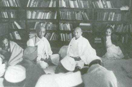 Gandhi attends a Congress Working Committee meeting at Anand Bhavan in Allahabad, Vallabhbhai Patel to the left, Madame Vijaya Lakshmi Pandit to the right.