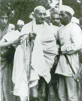 Gandhi walking to meet Viceroy Lord Linlithgow in Simla, with Rajkumari Amrit Kaur behind him, September 12, 1939.