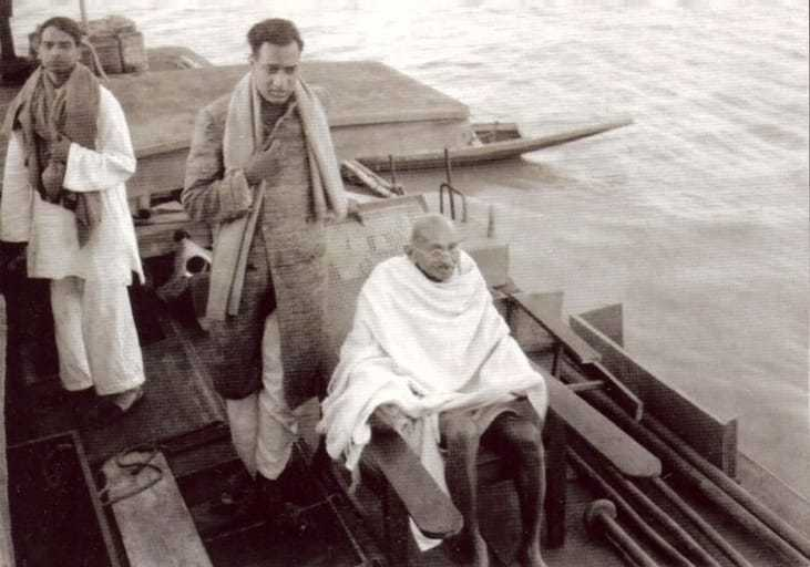 Sudhir Ghosh (left), Ramkrishna Bajaj (centre) and Mahatma Gandhi on a boat on way to Midnapur (East Bengal), December 24, 1945.