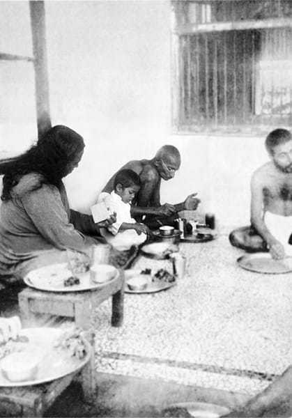 Swami Paramhansa Yogananda and Gandhi taking their meals at Satyagraha Ashram, Sevagram, August 26, 1935.