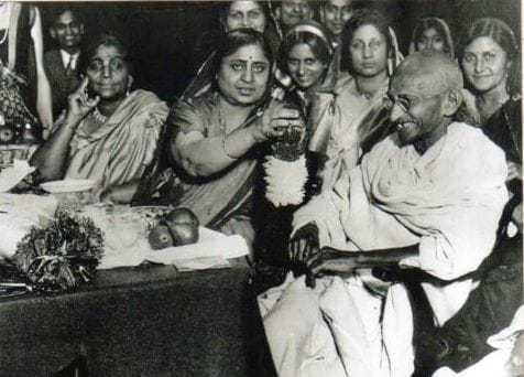 Mahatma Gandhi with women. Sarojini Naidu is on the left. Before 1942.