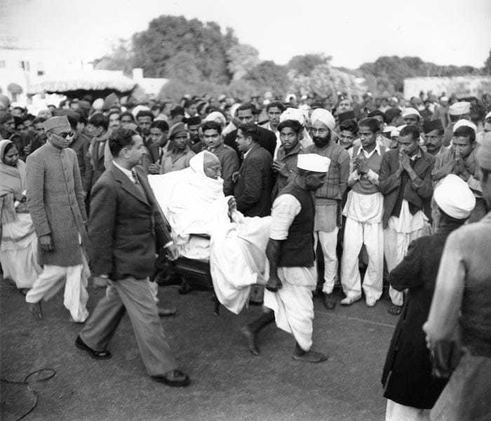 Mahatma Gandhi, is carried from his main house to the Garden area after breaking a five-day fast in New Delhi, India on January 21, 1948.