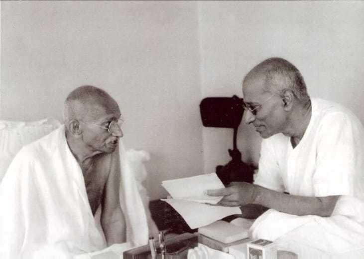 Mahatma Gandhi speaking to co worker Chakraborty Rajagopalachari Mumbai Bombay Maharashtra. India. September 1944.