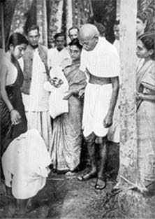 Gandhi giving solace to the sufferers of Noakhali. December 1946.
