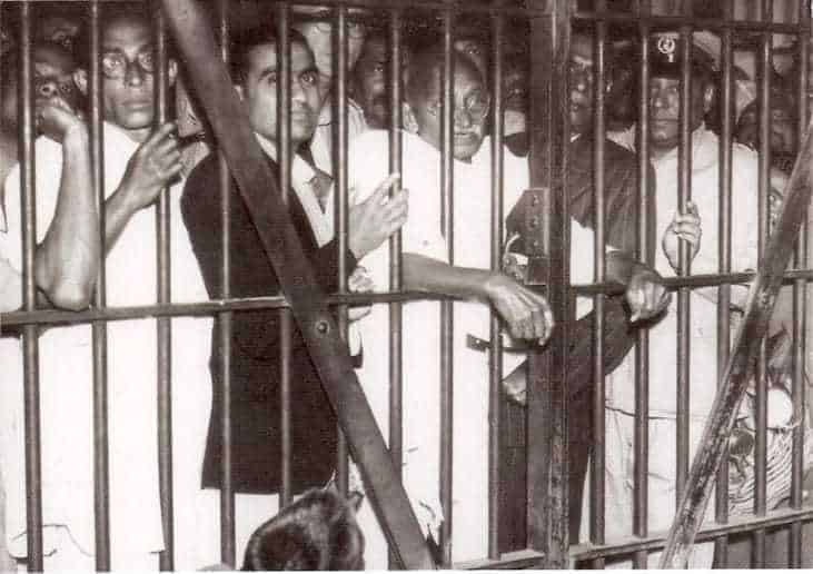 Gandhi is being seen off at the jail gate of Dum Dum Jail, Calcutta, by some of the security prisoners and jail officials. January 17, 1946.