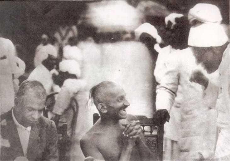 Gandhi at a party given by Srinivas Iyengar, Madras, September 1921.