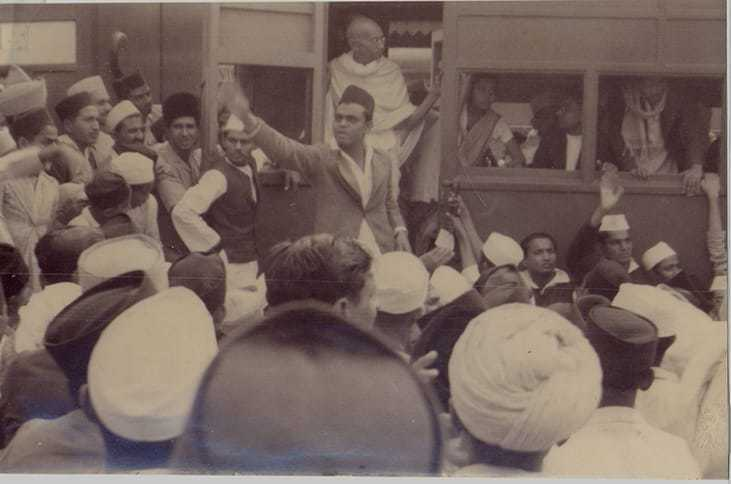 Mahatma Gandhi in a train with crowd. Before 1942.