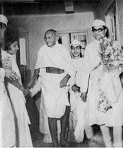 Gandhi with Shantikumar Morarjee visit Kasturba National Memorial Trust's office at Scindhia House, Bombay. April 13, 1945.