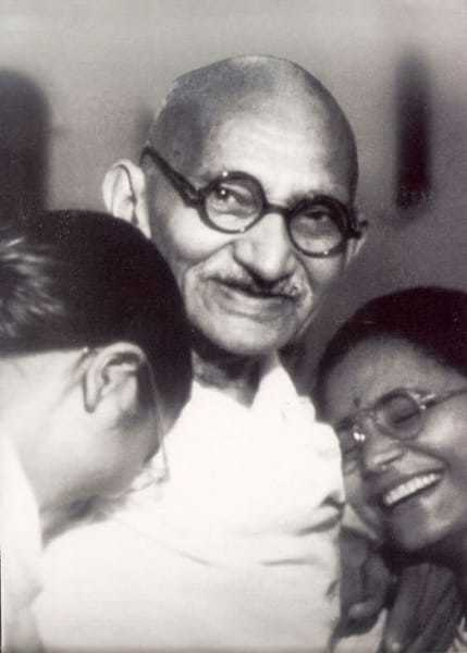 Mahatma Gandhi with his grand daughter Manu (left) and the wife of his grand nephew Kanu Gandhi, Abha, at Birla House, New Delhi, in December 1947.