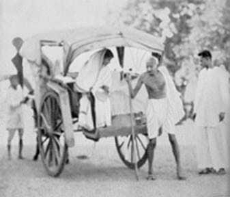 Mahatma Gandhi arriving at Wardha from Sevagram by a tonga, 1936.