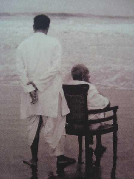Gandhi with his son Devdas at Juhu Beach, Mumbai, Maharashtra, India. May 1944.
