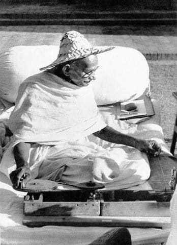 Mahatma Gandhi wearing a Noakhali hat whilst spinning at Birla House New Delhi India. November 1947.