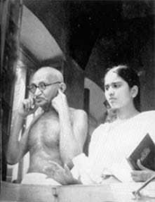 Gandhi plugging his ears against the deafening din of the demonstrators before his Beliaghat residence at Calcutta, August 15, 1947