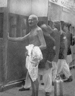 Gandhi just before entering a train, October 1937.