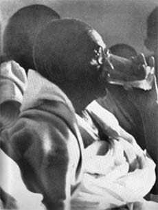 Gandhi breaking his fast. Delhi. January 18. 1948.