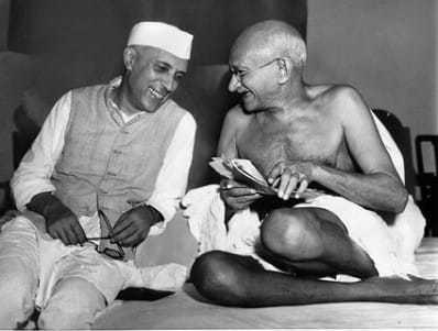 Jawaharlal Nehru sharing a joke with Mahatma Gandhi, Mumbai. July 6, 1946.