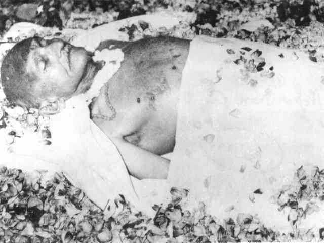 Gandhi on the deathbed, covered with flowers. January 31, 1948.