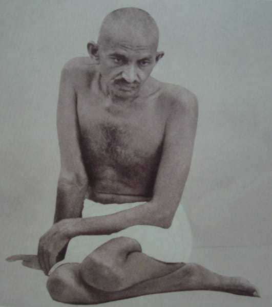 Mohandas Gandhi in a characteristic pose, 1924.