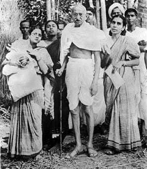 Mahatma Gandhi with Abhaben Gandhi during his tour of Bengal province in 1946.