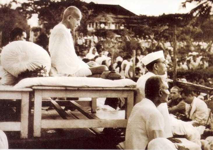 Mahatma Gandhi at a prayer meeting in Birla House, Bombay, 1946.