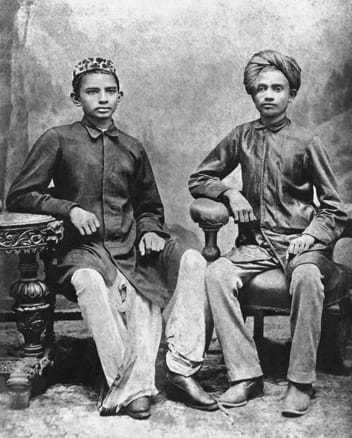 Mahatma Gandhi with his class mate Sheikh Mehtab (right) at Rajkot, 1883. Date, 1883.