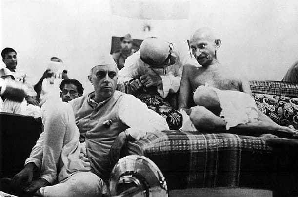 Mahatma Gandhi sitting next to Jawaharlal Nehru at the AICC General Session, 1942.