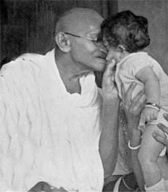 Mahatma Gandhi with a child, Poona. September 1945.