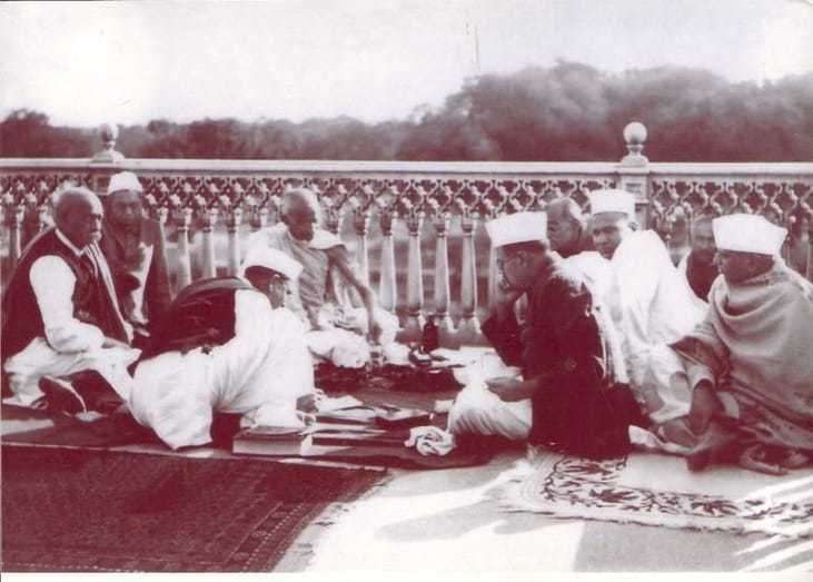 Gandhi taking a meal during his convalescence, June 1933.