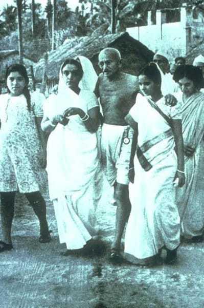 Mahatma Gandhi with his hostess, Sumati Morarjee at Juhu Beach, Bombay, May/June 1944.