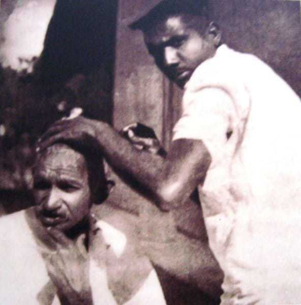 Getting shaved during the Dandi March (Salt Satyagraha). March 1930.