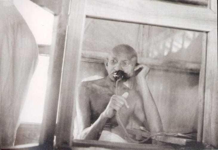 Mahatma Gandhi telephoning from the office hut at Satyagraha Ashram, Sevagram,1938.