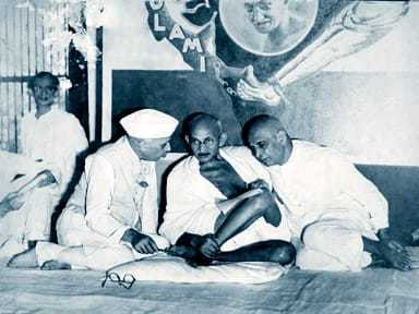 Pandit Jawaharlal Nehru Mahatma Gandhi and Sardar Patel at a special session of the All India Congress Committee to consider a proposal for the formation of Congress. 1933.