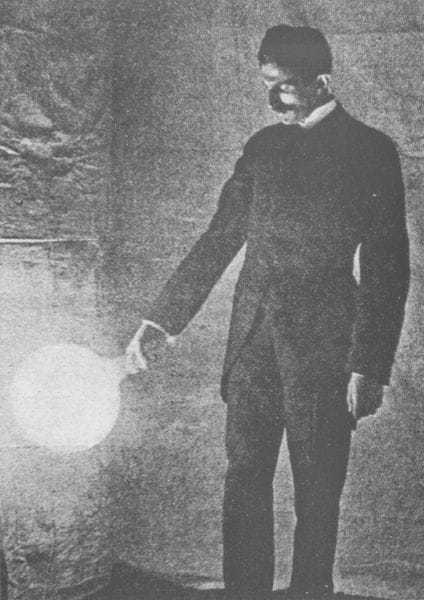 Some experiments in Tesla's laboratory with currents of high potential and high frequency. Lighting a disconnected vacuum bulb of 1,500 C.P. by high-frequency currents - photograph taken by the light of the bulb itself, exposure about two seconds.
