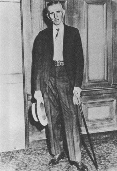 Tesla in his hotel room in the late 1930's. After his accident, he walked with a cane.
