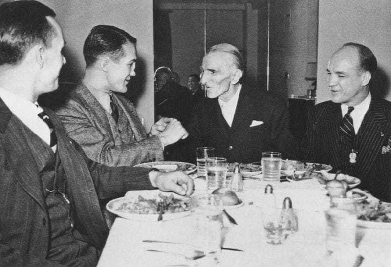 Tesla meets King Peter II of Yugoslavia on July 15, 1942. Tesla's nephew, Sava Kosanović, is third from the left.