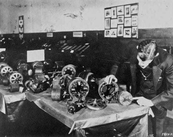 Tesla with some of his induction motors.