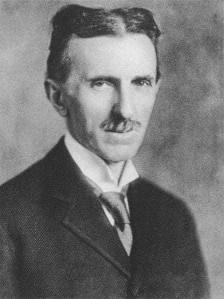 Portrait photograph of Nikola Tesla in 1920 at age sixty-four.
