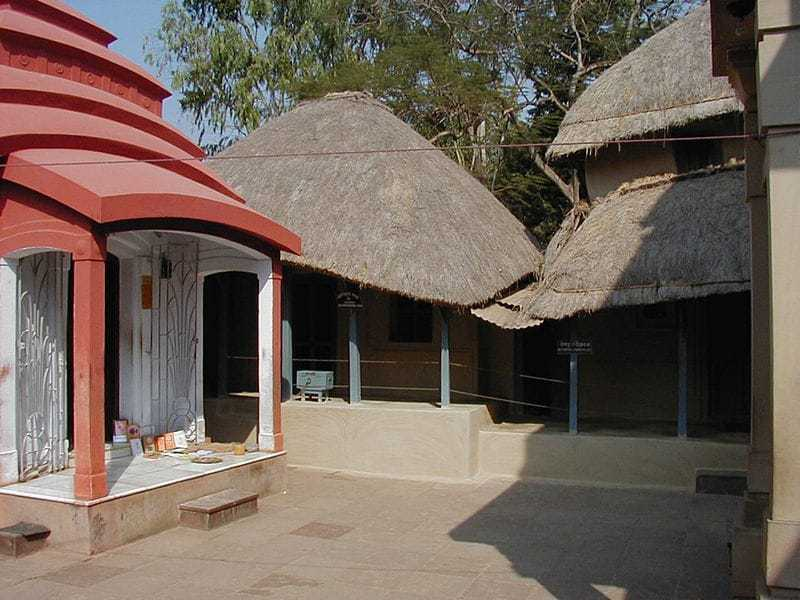 The Hut at Kamarpukur where Ramakrishna was born: The small house at Kamarpukur where Ramakrishna lived (centre). The family shrine is on the left, birthplace temple on the extreme right (from the original)