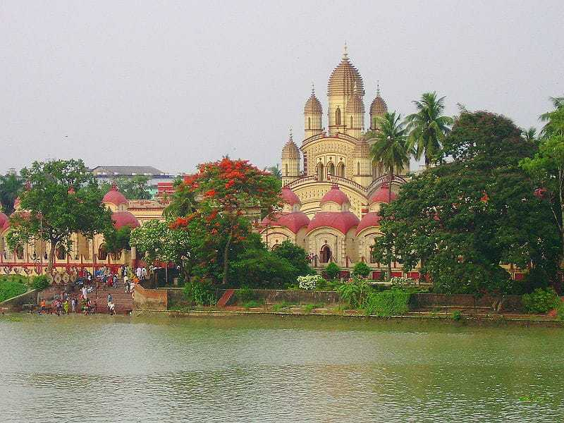 The DAKHSHINESWAR TEMPLE was founded by RANI (Queen) of Janbaazar RASHMONI in 1855 on the east bank of the Ganges river. The main temple is of NABARATNA (with 9 spires) style. It houses a KALI idol standing on the chest of a lying SHIVA. The two idols are placed on a thousand-petaled lotus made of silver. Besides the main temple, there are 12 smaller SHIVA temples & a Temple dedicated to LAXMI-NARAYANA. This is a major place of pilgrimage in West Bengal, especially for the followers of SRI RAMAKRISHNA DEVA.